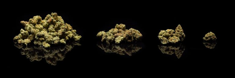 Piles of cannabis against a black background